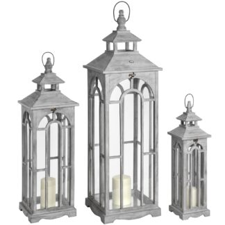 A Set Of Three Wooden Lanterns With Archway Design made with a wooden frame with inset glass panes. Space for candles inside accessible via a hinged door.